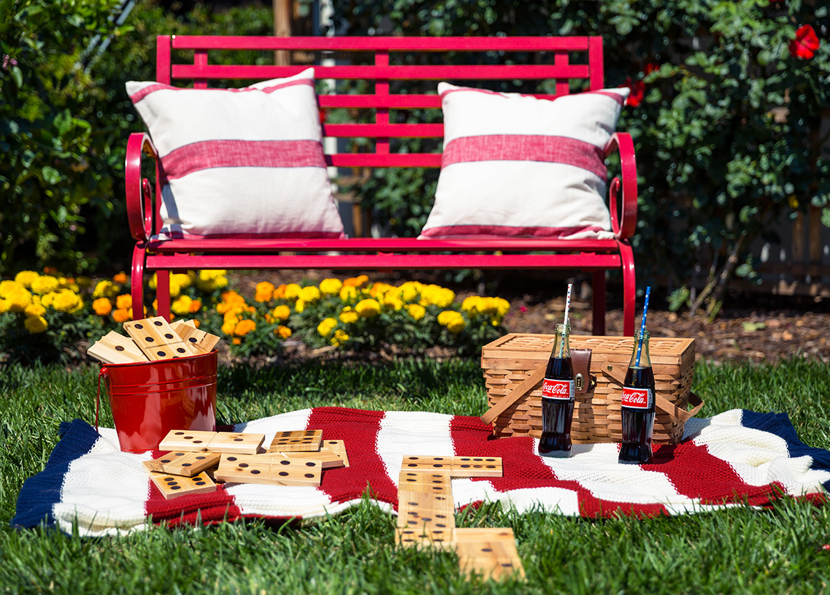 Red Bench with Pillows